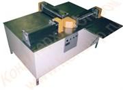 Машина для прокатки по толщине и резки дисковыми ножами в  продольном и поперечном направлении конфетных масс