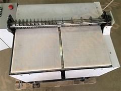 Машина дисковой одновальной, двухсекционной продольно-поперечной резки пластов кондитерских масс на корпуса конфет с  подвижным рабочим столом